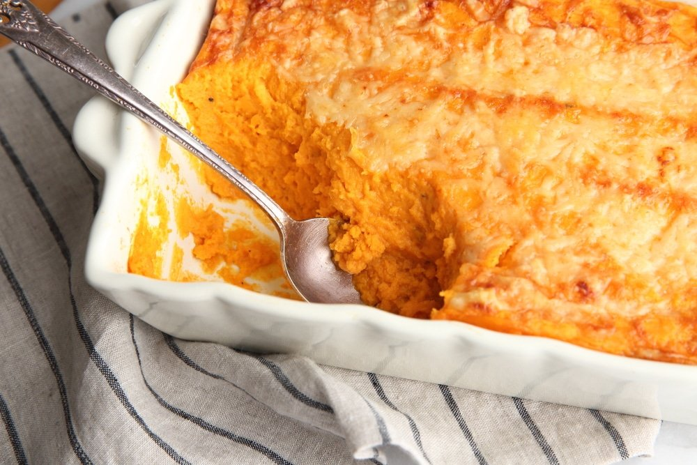 Sweet Potato Souffle in baking dish with spoon