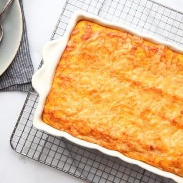Sweet Potato Souffle in baking dish on cooling rack