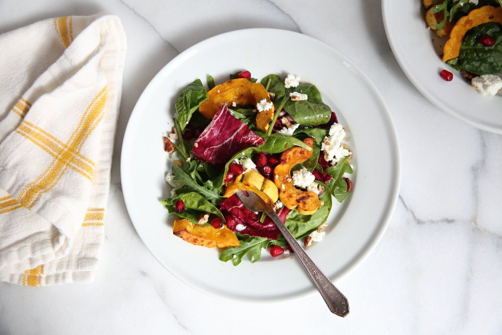 Overhead shot of the roasted squash salad on plate with a fork.