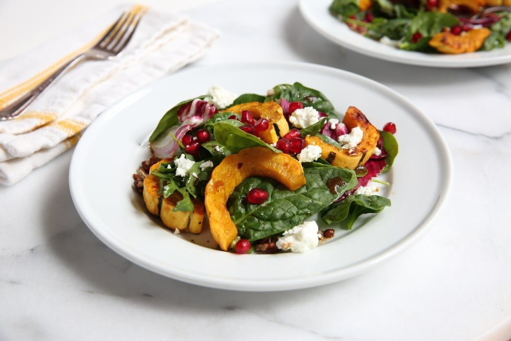 Roasted squash salad on plate with fork