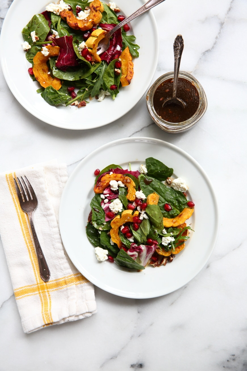 Roasted squash salad on plates with dressing