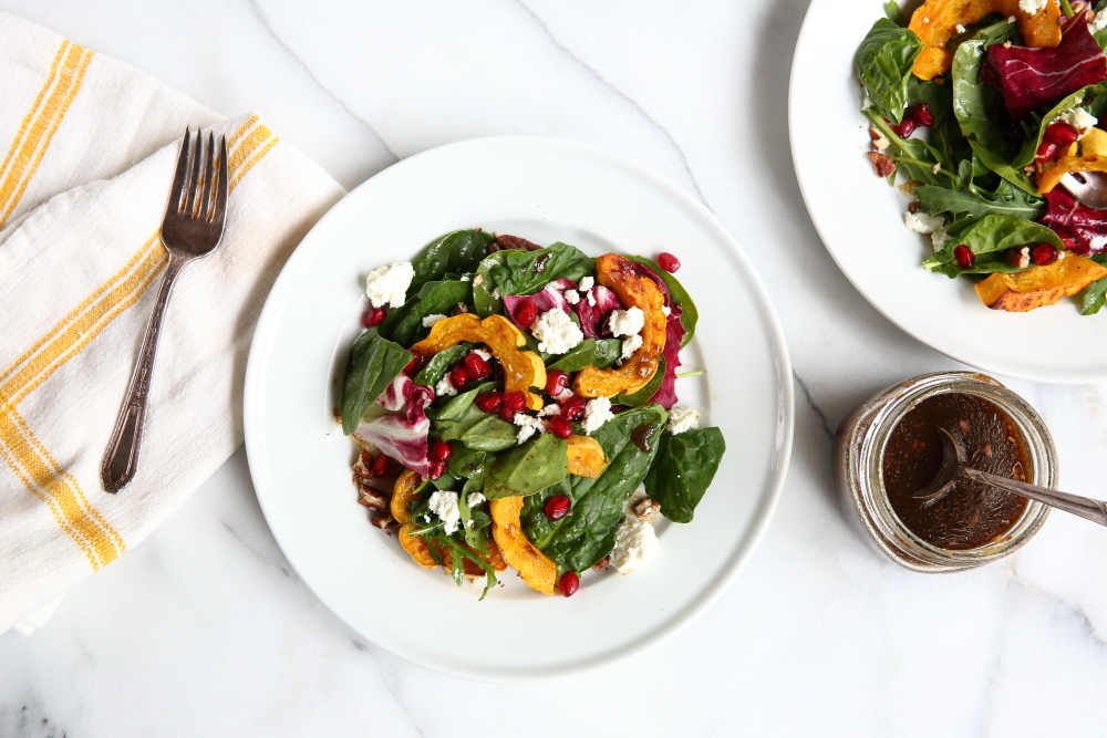 Roasted Squash Salad on plates with maple balsamic dressing