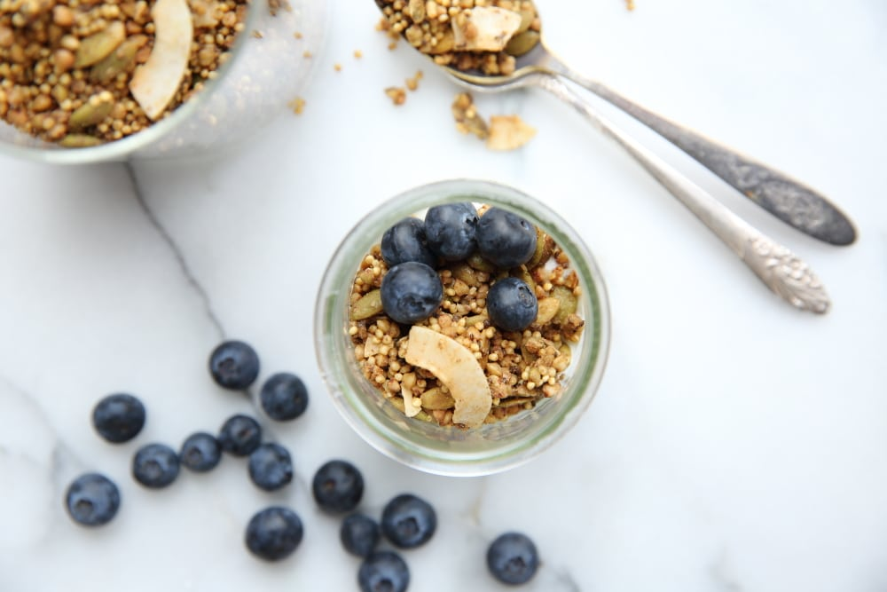 Overhead shot of millet granola in jar with blueberries