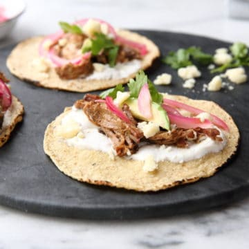 Slow cooker carnitas tacos with pickled red onions