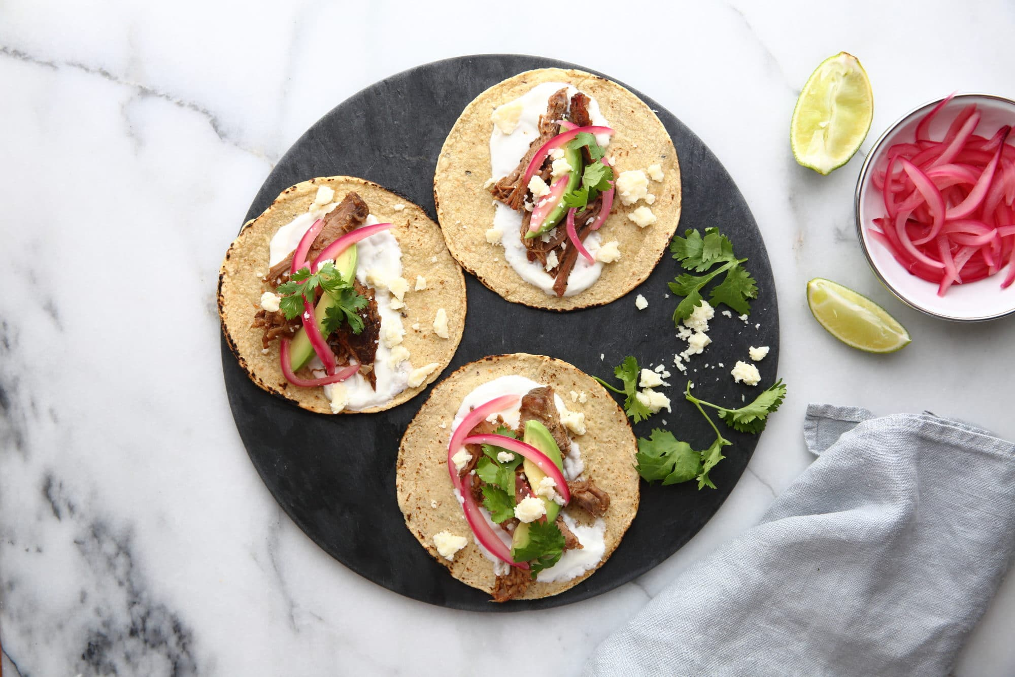 Slow cooker carnitas tacos on plate