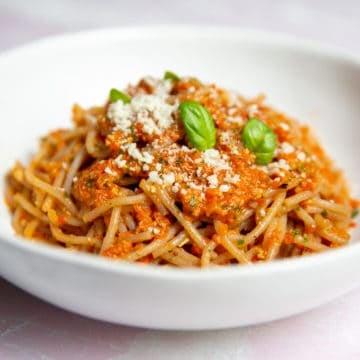 Red pepper pesto pasta in a bowl.