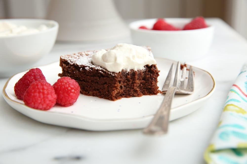 Close-up of gluten free chocolate cake on plate with fork