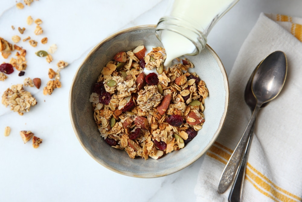 gluten free granola recipe in bowl with milk pouring over