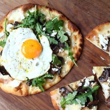 Flatbread pizzas on serving board