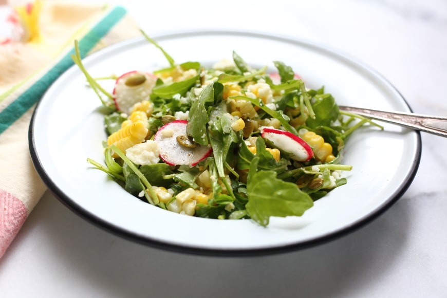 This sweet and smoky corn salad with arugula, radishes and cotija is like a lightened up version of Mexican street corn!