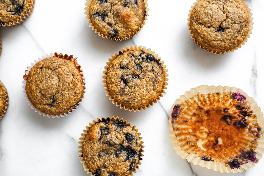 Overhead shot of blueberry blender muffins lined up on the counter.