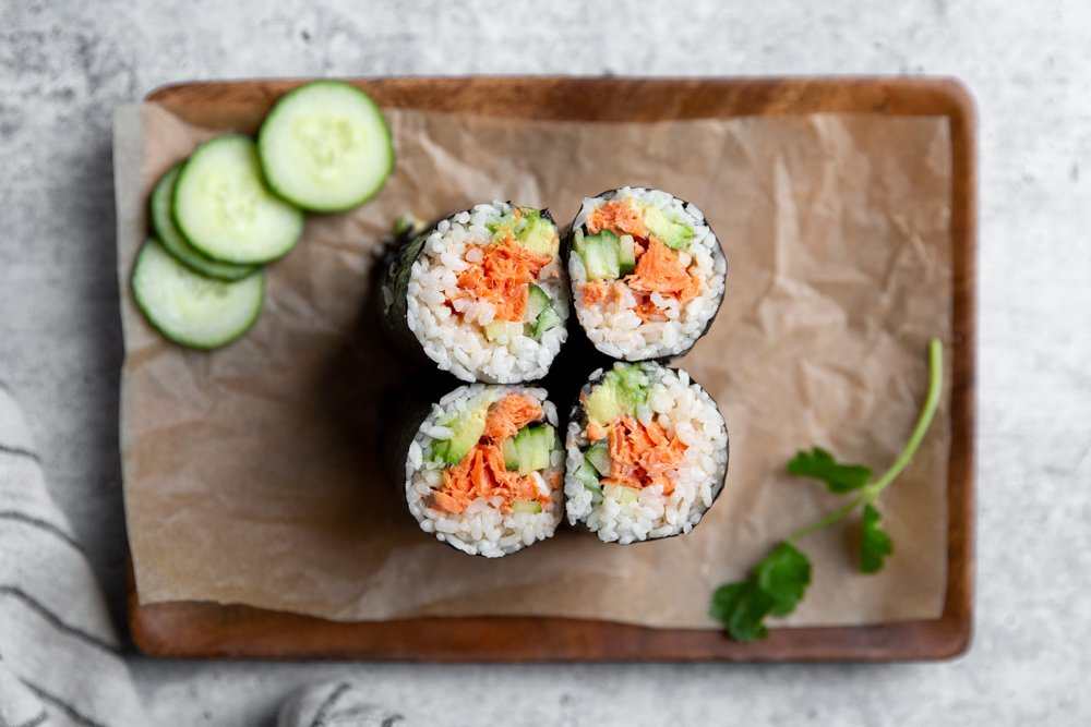Spicy salmon sushi burritos on a serving platter.