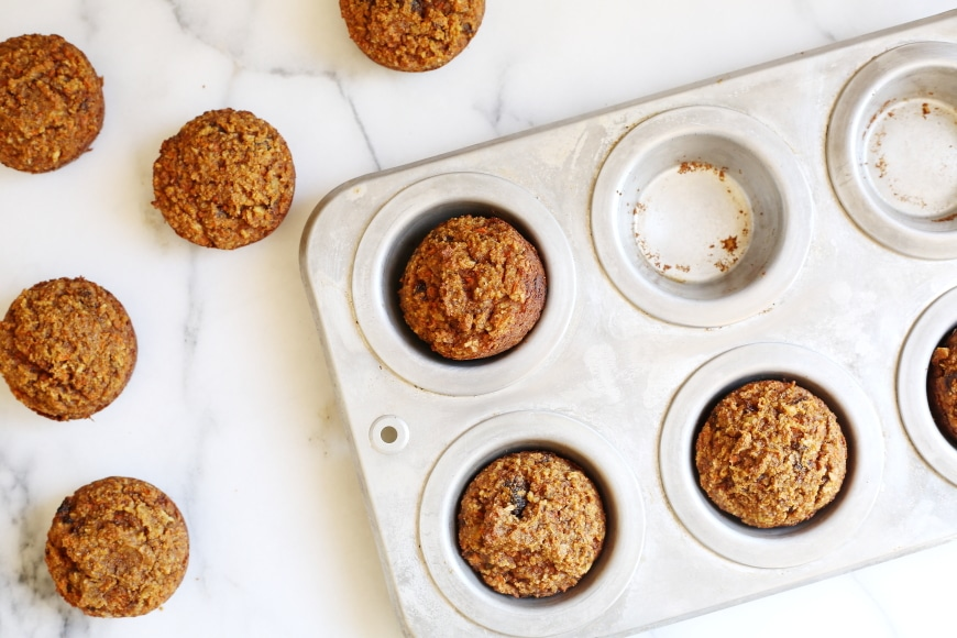 These naturally sweetened carrot cake muffins are gluten-free, grain-free, and are packed with carrots, but who cares, because THEY TASTE JUST LIKE CARROT CAKE!