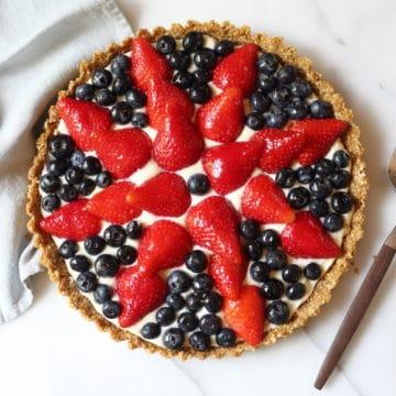 Overhead shot of gluten free berry tart on countertop.