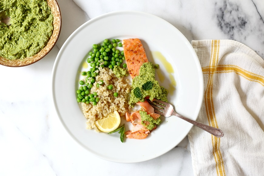 Perfectly cooked roasted salmon is one of the quickest and easiest of weeknight meals, and this maple-glazed version with sweet pea pesto will rock your world.