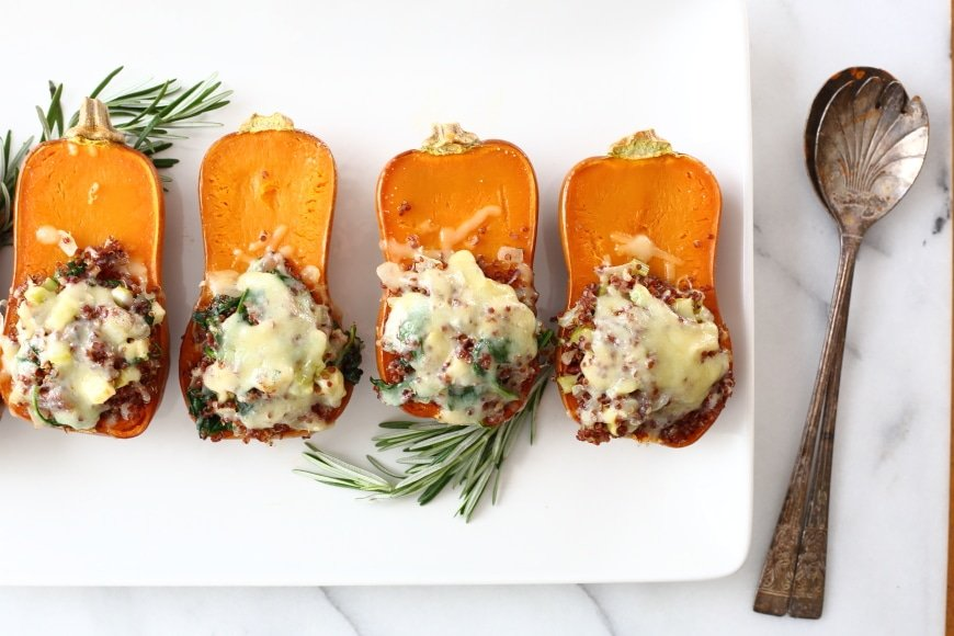 These quinoa and apple stuffed honeynut squash are a stunning vegetarian side dish or delicious main course!
