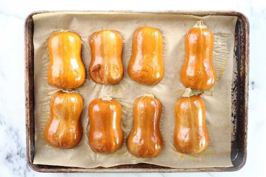 Roasted honeynut squash on a baking sheet
