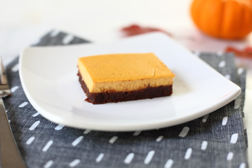Gluten free pumpkin cheesecake brownies on plate