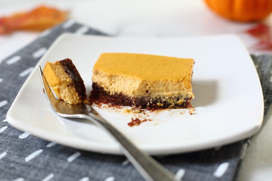 Gluten Free Pumpkin Cheesecake brownies on plate with fork