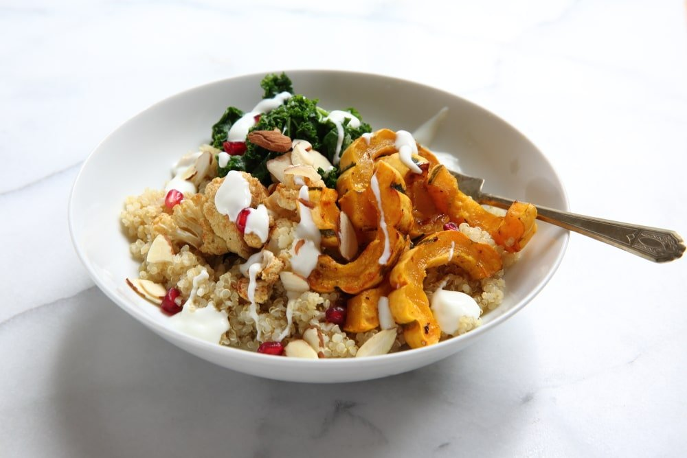 Roasted delicata squash on grain bowl