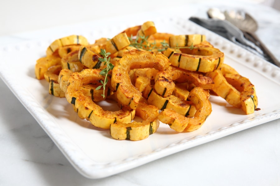 Roasted delicata squash on platter