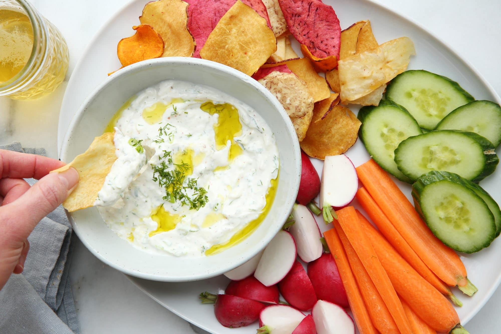 Yogurt feta dip with potato chips and veggies