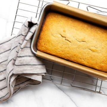 Gluten free banana bread in pan on cooling rack