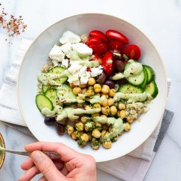 Mediterranena quinoa bowl with green tahini sauce