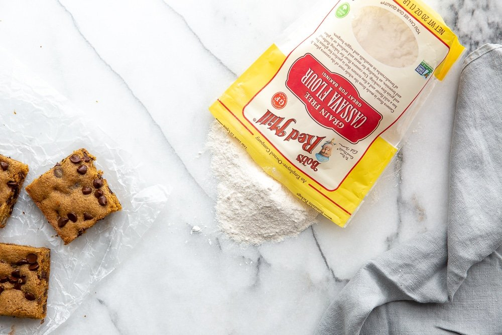 Cassava cookie bars on counter with bag of cassava flour