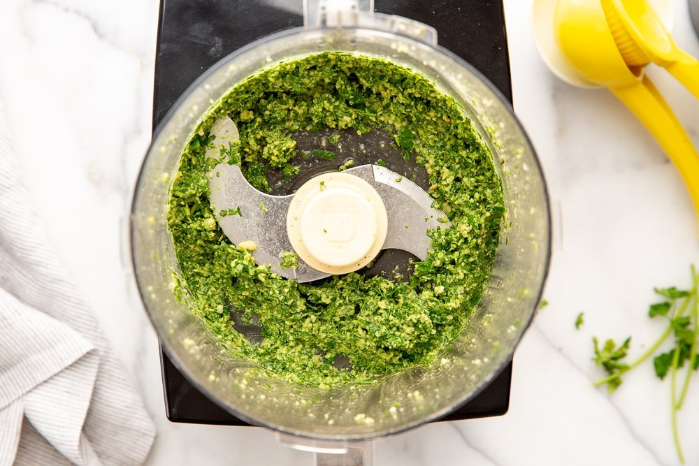 Ingredients for green sauce in food processor