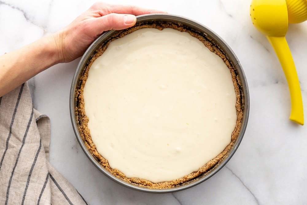 Creamy lemon pie with almond crust in springform pan