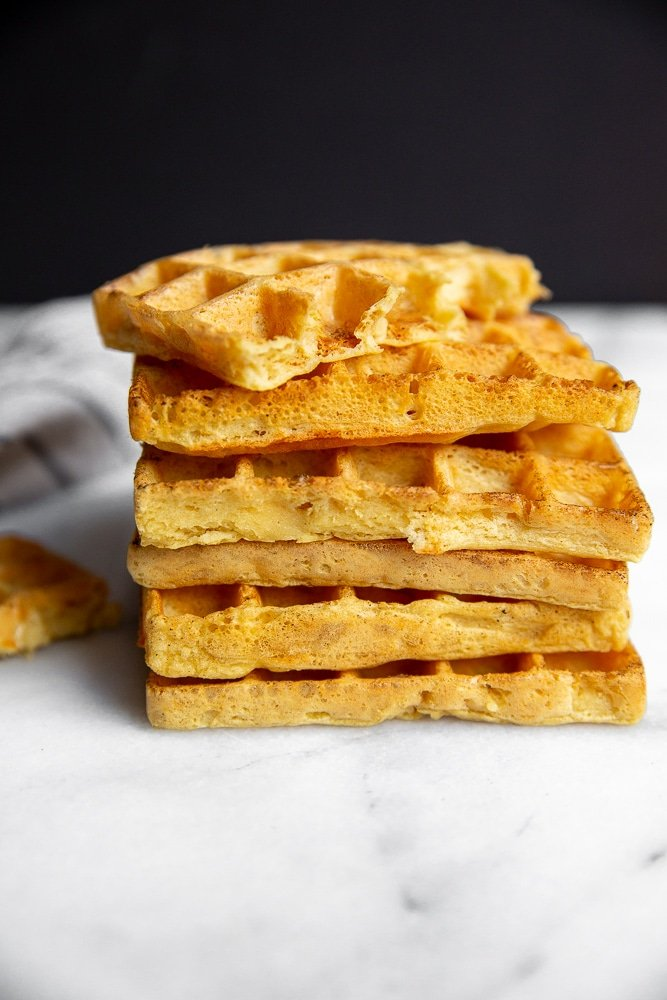 Chickpea waffles stacked in a pile on the counter