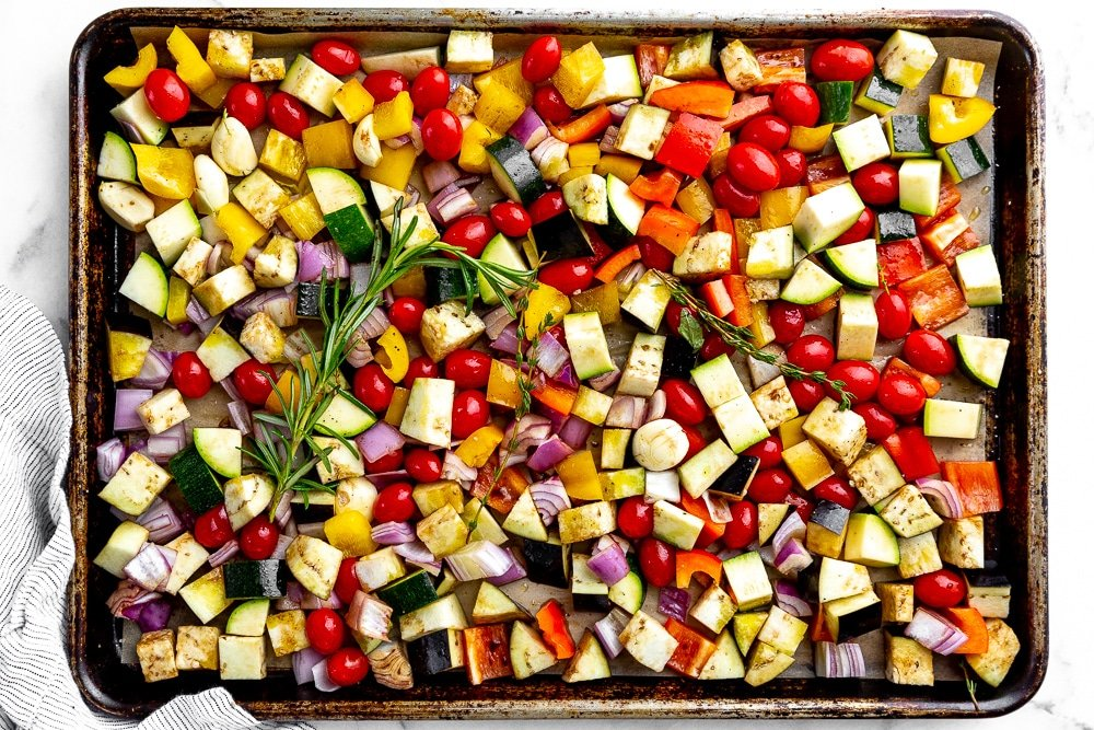 Chopped vegetables for the easy ratatouille recipe, spread out on a baking sheet