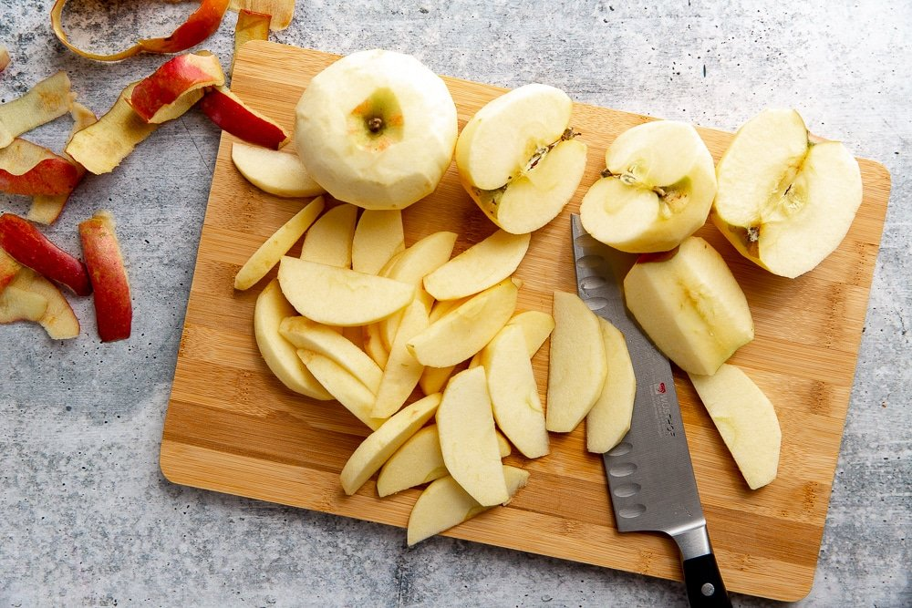 Process shot showing how to slice the apples for the cobbler