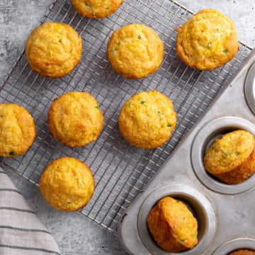 Jalapeno Cheddar Cornbread muffins on a cooling rack.