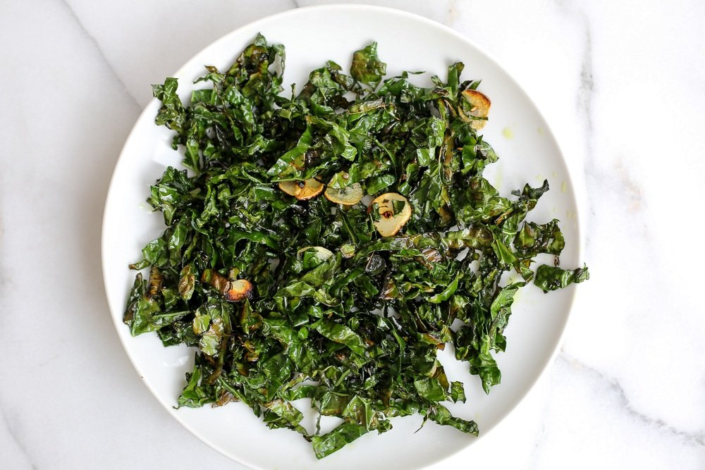 Plate of sauteed kale, to garnish the soup.