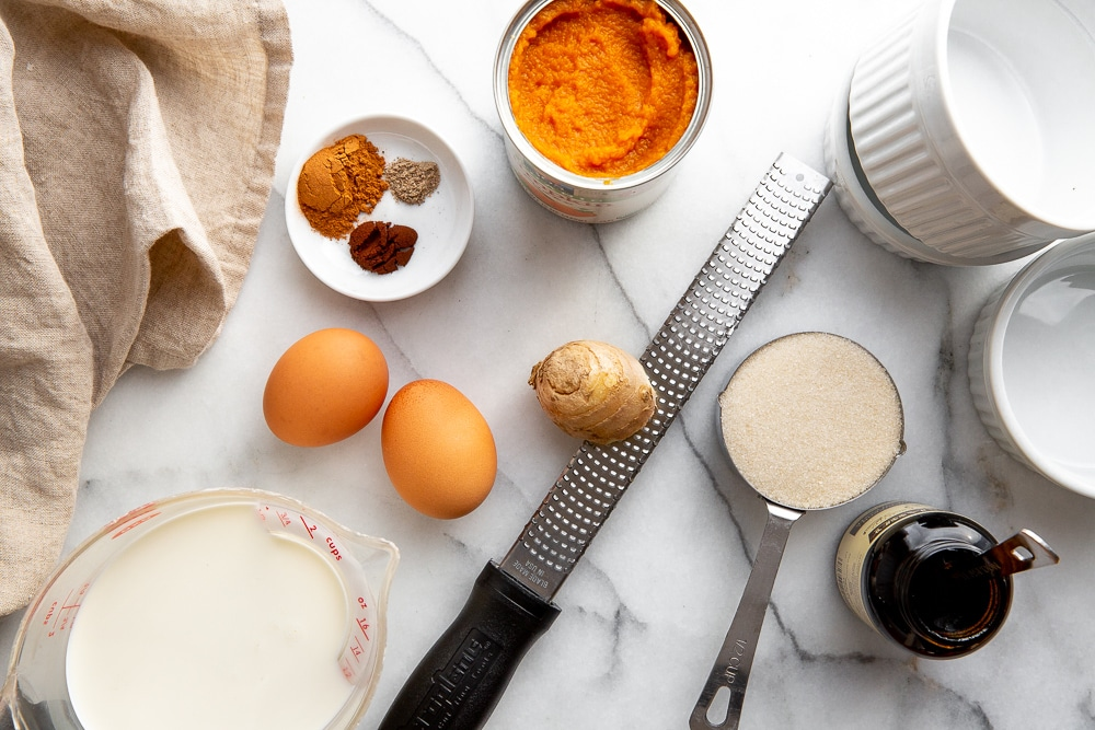 The ingredients for the crustless pumpkin pies arranged on a counter.