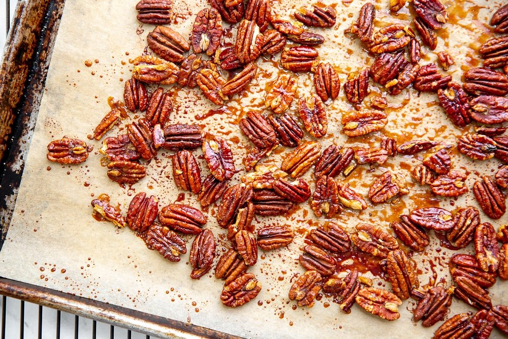 Candied maple pecans on a baking sheet.