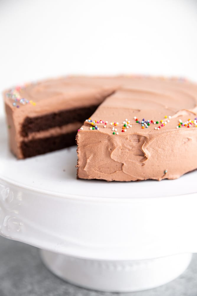 Side view of the chocolate cake on a cake stand.