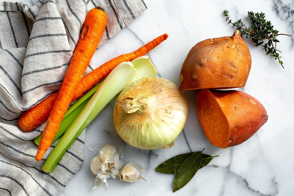The ingredients for the vegetable potage soup laid out on a countertop.