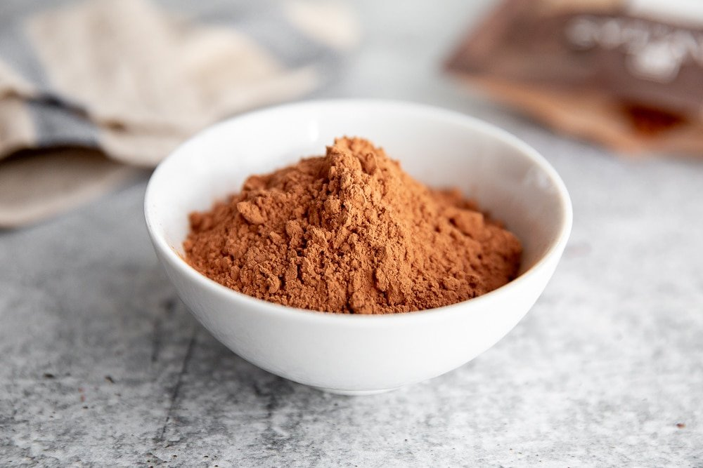 Close up of raw cacao powder in a bowl.