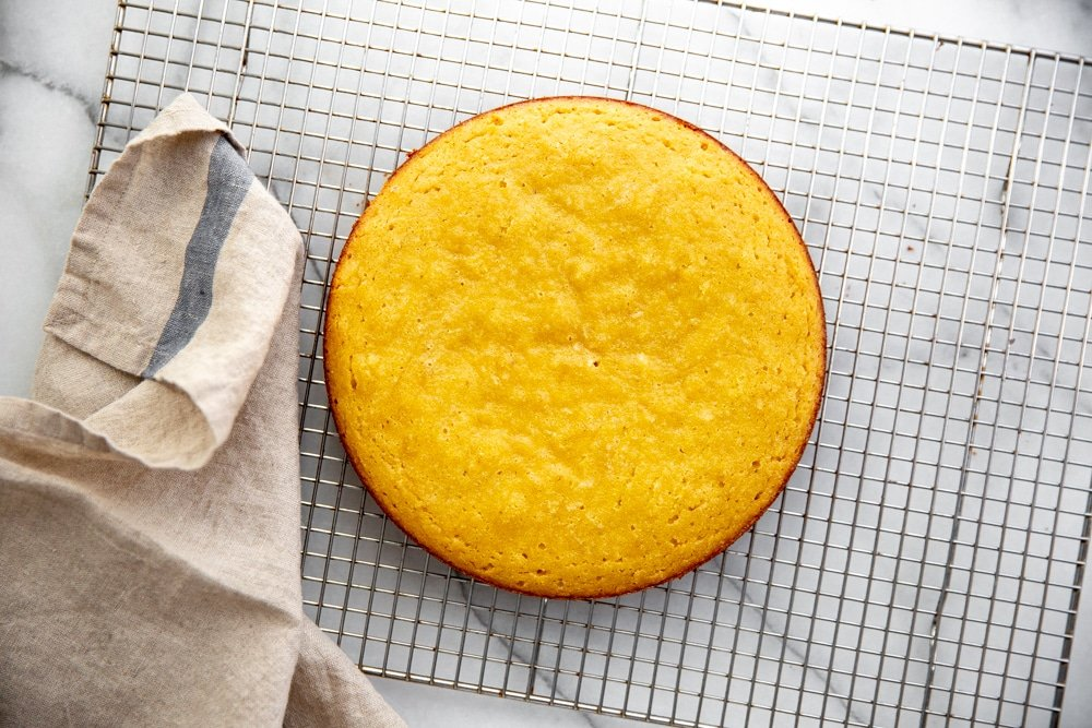 Almond coconut cake on a cooling rack.