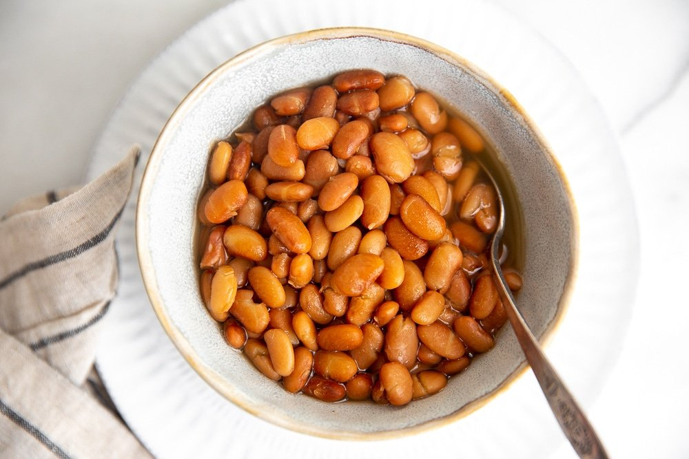 Overhead close-up of a bowl of pinto beans.