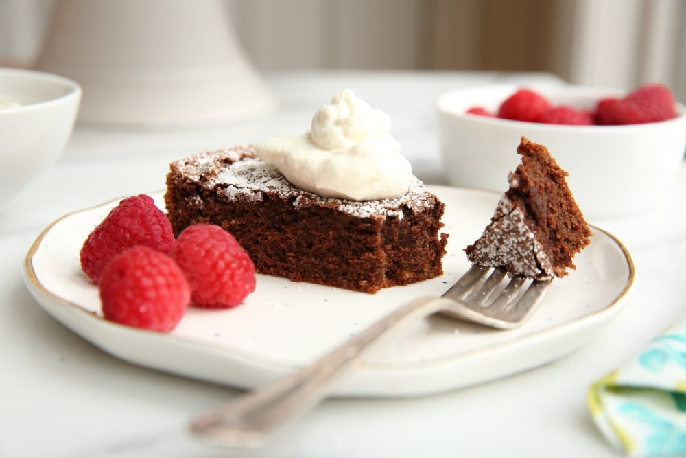 A slice of chocolate cake, showcasing easy pantry recipes.