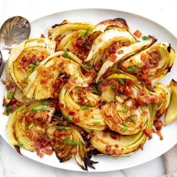 Platter of roasted cabbage wedges drizzled with a warm bacon vinaigrette.