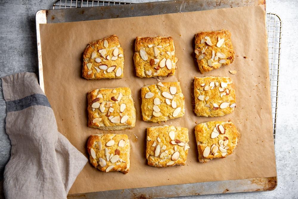 Gluten free shortcakes on a baking sheet.