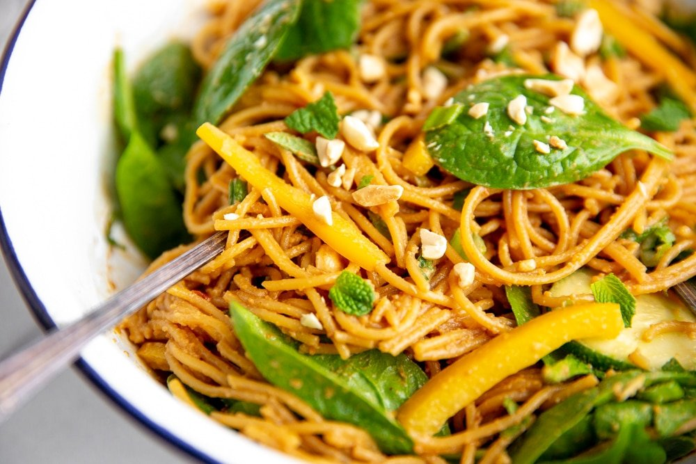 Close up of the Thai peanut noodles after having been tossed with the vegetables.