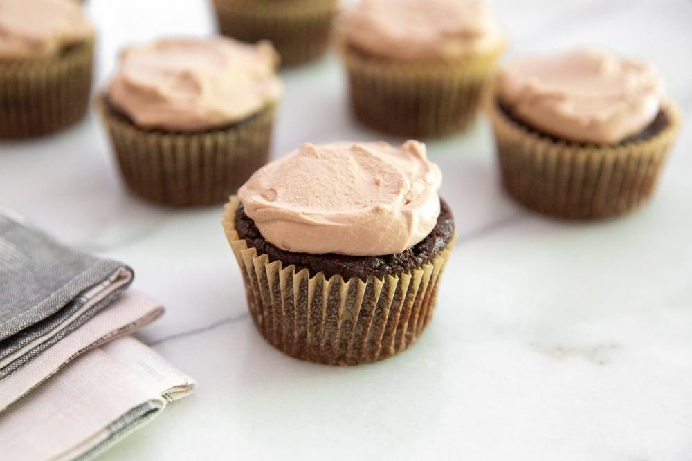 Chocolate quinoa cupcakes on a countertop.