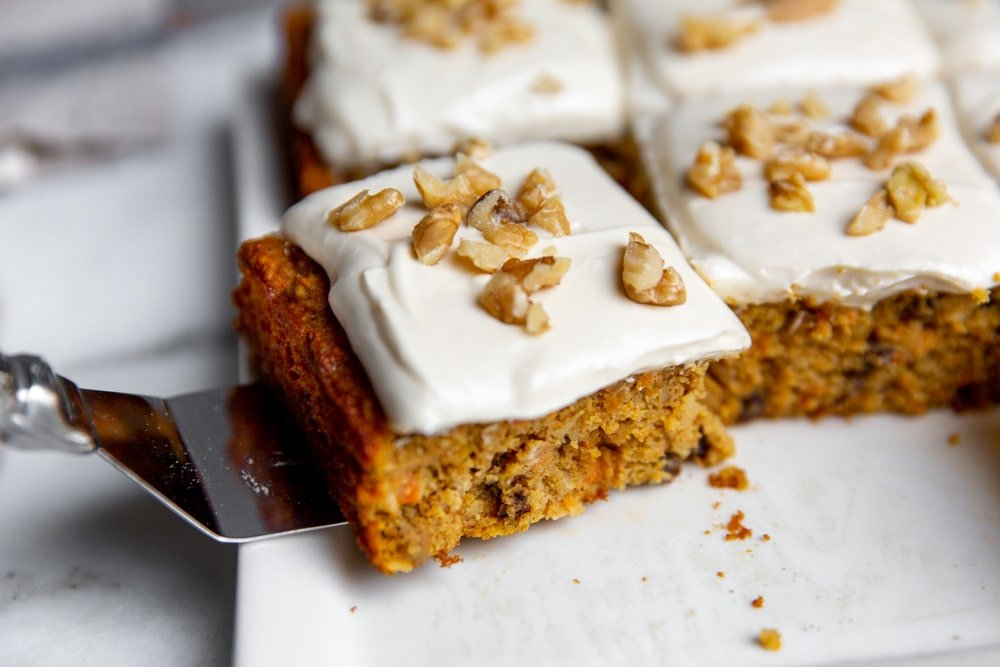 Spatula picking up a piece of carrot cake.