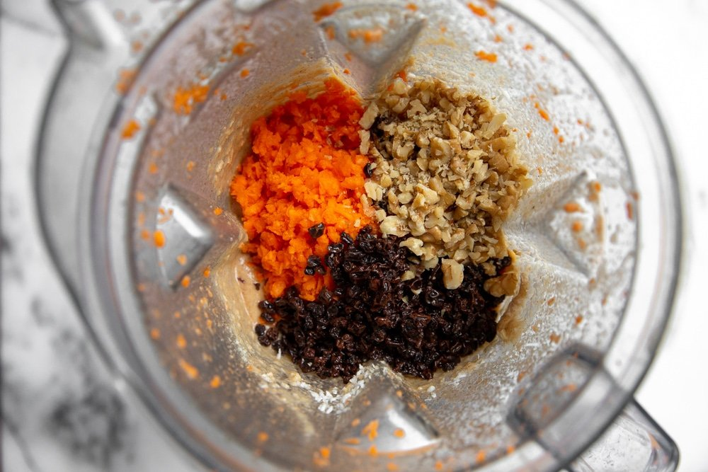 Process shot showing the carrot cake ingredients in a Vitamix blender.